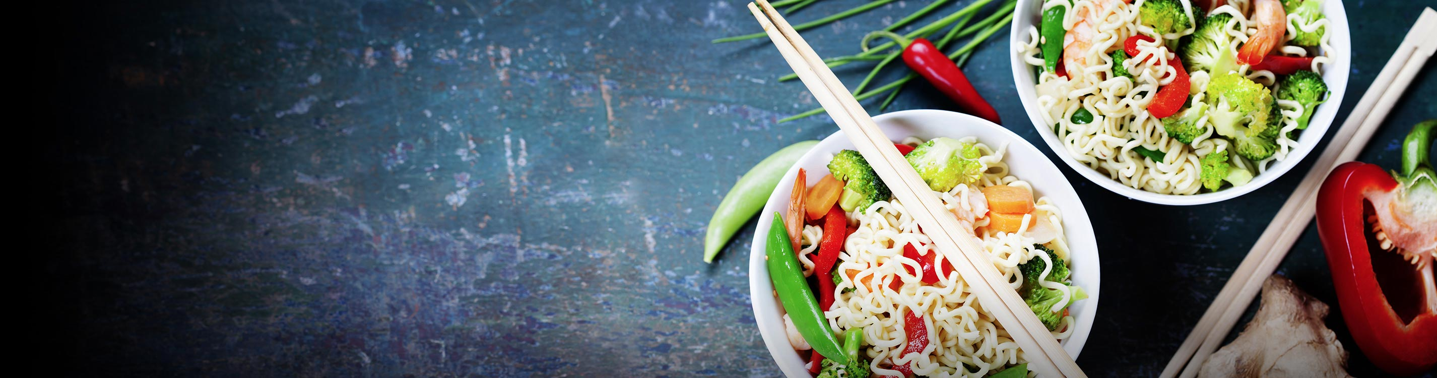 Asian noodles in bowl with chop sticks