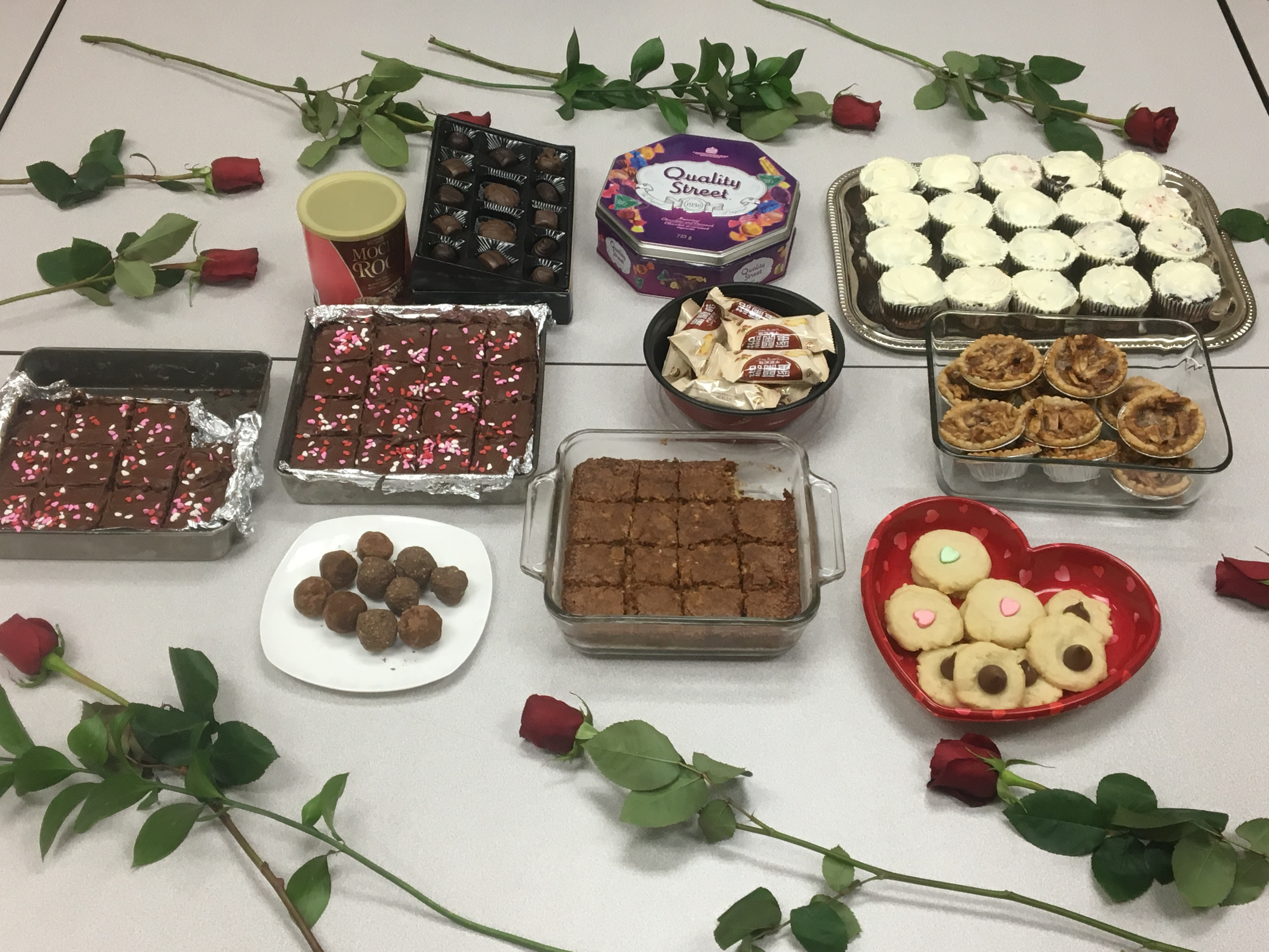 Happy Valentine's Day! Celebrating with some delicious treats created and/or shared by the Dealers Ingredients employees. Roses on the table was a nice surprise from the boss.